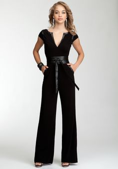 Knit or woven jumpsuit, faux leather binding on neck, pockets, and shoulder seam.  Caps sleeves, back zip, deep V-neck back, faux obi belt, slash pockets.