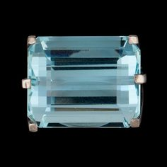 A huge aquamarine stone - there is a ring under there!