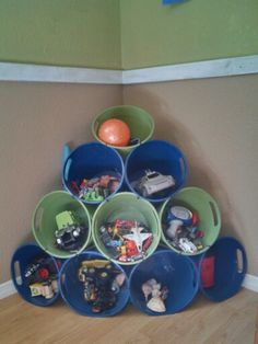 Plastic buckets from Dollar Tree zip tied together.. Perfect to hold Dallas' little toys!