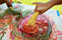Spaghetti painting with cooked or uncooked Spaghetti brushes.