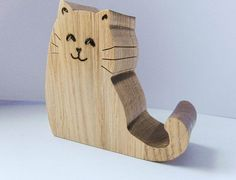 Hey, I found this really awesome Etsy listing at https://www.etsy.com/listing/214845013/cat-phone-holder-desk-phone-holder