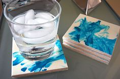 I made these tile coasters using ceramic tiles, Glossy Mod Podge and my two-year-old's fingerpainting artwork. Making your own decoupage tile coasters is crazy easy, I love how they turned out, and Elise got to dig her hands into some goo. These handmade ceramic tile coasters were a DIY birthday
