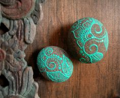 2 turquoise floral painted rocks. $20.00, via Etsy.