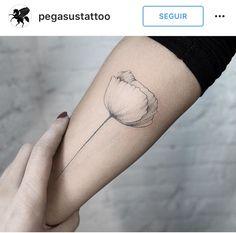 Fine-line tulip forearm tat