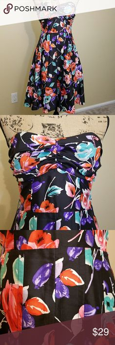 """Express Floral Strapless Silk Dress Great condition, no deodorant stains. Bandeau top with vertical stays to help with shape. Back zip (the zipper does work, but my dress form is too big!). Back length is approx 28"""". 100% silk exterior with polyester lining. Tag says dry clean only. Express Dresses Mini"""