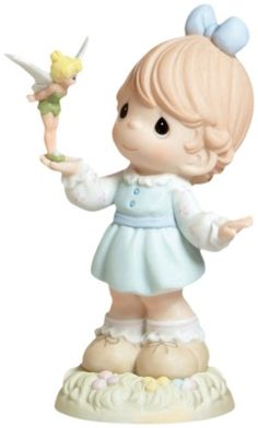"Precious Moments Disney Collection ""Make Every Day Magical""  Figurine Precious Moments http://www.amazon.com/dp/B000J3ATSQ/ref=cm_sw_r_pi_dp_DHg2tb0F42CPHVRV"