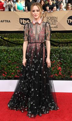 The 2017 SAG Awards | CLAIRE FOY wears lily-of-the-valley Valentino with a contrasting Peter Pan collar and Tiffany & Co. jewelry.