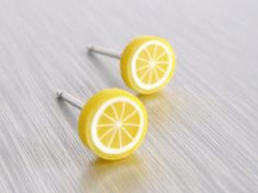 Tiny Lemon Earrings - yellow miniature citrus fruit slice studs on little pierced surgical steel posts - When Life Hands You Lemons.... $11.00, via Etsy.