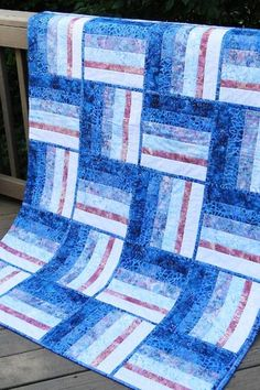 This red white and blue batik quilt would look perfect in a little boy's room.