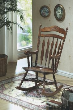 Monarch Specialties Embossed Back Rocking Chair, Dark Walnut. Whether you are a new mom looking to soothe a baby or just want place to sit and relax, this country styled wooden rocking chair will be a lovely addition to your home. This high back rocker has a shaped top splat with detailed floral carvings and is finished in dark walnut. Soft curved arms frame the seat, with turned spindle supports. Turned legs above the wood rocker base complete this charming country style look and add the…