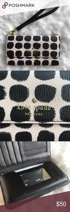 "Kate Spade Cedar Street iPhone Wristlet Saffiano leather with matching trim and 14k gold plated hardware. Trifold iPhone wristlet with snap closure. 4 credit card slots, 1 ID slot, and interior side pocket. Fits iPhone 6, 6s, and 7. Small mirror inside that reads ""smile"". PLEASE NOTE: the detachable wristlet strap was lost so I've replaced it with my own that matched the wristlet. The wristlet is brand new and never been used but can not locate the strap. I will include the replaced strap…"