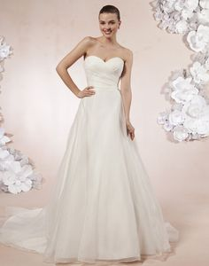 A sweetheart neckline in pleated organza with a natural waist on this  ball gown. Buttons cover the back zipper to the natural waist and this  style has a chapel length train.
