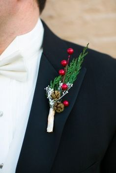 Christmas Wedding Boutionniere, groomsmen have red berries, groom has no red, only green and white.