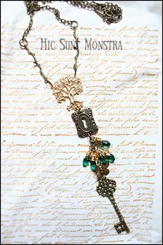 """""""Yggdrasill"""" - the long necklace freely (very freely) inspired by the Nordic Mythology, in the wonderful and perfectly matching shades of green, raw brass and antique bronze."""