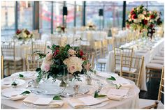 The Bridge Building Nashville Tennessee tablescape with gold chivari chairs, clear gold rimmed chargers, and magnolia leaf table numbers.