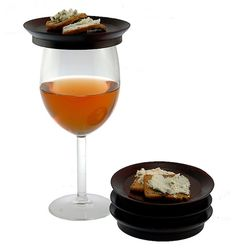 These appetizer plates that fit on top of your wine glass will make wine and cheese night wayyyy more manageable. | 23 Products For People Who Just Really Like Wine