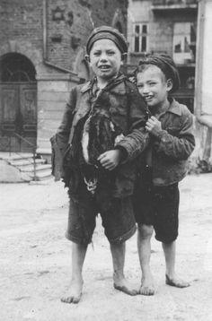 Jewish ghetto children in front of a synagogue, Rzeszów, Poland, c1942