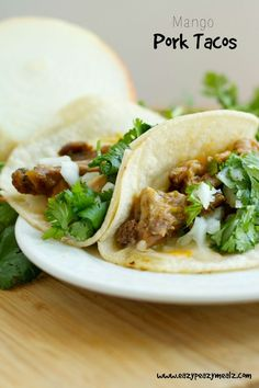 Mango Pork Tacos: Slow cooker tacos that are flavored with mango, and taste amazing with almost no work required. A family favorite. - Eazy Peazy Mealz