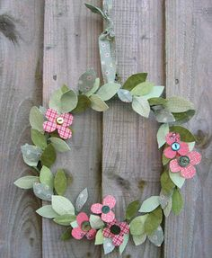 spring-use scrapbooking paper and craft wire to make a cute spring wreath (embellish with buttons, glitter, or whatever bling tickles your fancy!)