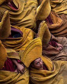 Tibetan monks with epic hats