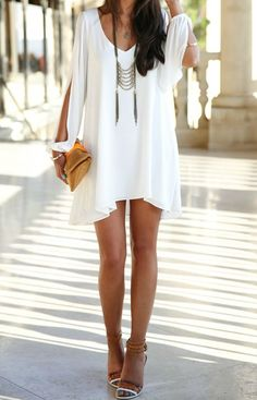 Pair this white dress with nude heels and red lippy. Perfect juxtaposition of innocent and sexy.