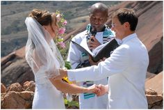 The groom reassures his bride during Red Rocks Amphitheater wedding