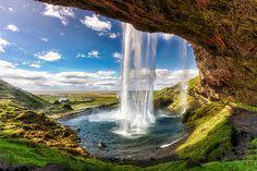Seljalandsfoss Waterfall Iceland - Amazing World Places Travel Guide To See Beautiful World Beautiful Waterfalls, Beautiful Landscapes, Famous Waterfalls, Places To Travel, Places To See, Europe Places, Places Around The World, Around The Worlds, Beautiful World