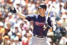 May 25, 2014; San Francisco, CA, USA; Minnesota Twins infielder Joe Mauer (7) signals for a teammate to advance on a pitch in the dirt against the San Francisco Giants in the third inning at AT&T Park. Mandatory Credit: Cary Edmondson-USA TODAY Sports