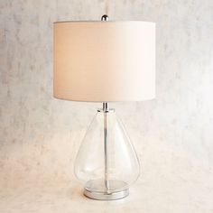 $99 A punch of texture and artistic glass lights up our lamp. Well, that and the light bulb. With its clean and simple silhouette, this little lamp will fit in almost anywhere. Talk about a bright idea.