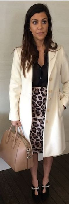 Kourtney Kardashian: Purse – Givenchy  Skirt – Kardashian Kollection  Shoes – Roberto Cavalli  Coat – Sisley