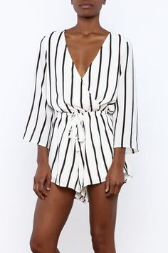 7fedc194f47a BELL SLEEVE ROMPER A black and white monochromatic striped romper featuring  crossover bust