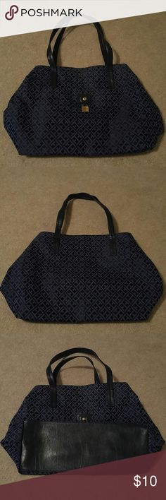 """TOMMY HILFIGER TOTE STYLE PURSE Gently used tote style purse by Tommy Hilfiger.  Royal blue with navy blue faux leather trim. Bag has a tapered style.  Opening at top is 12"""" wide, largest point in the middle is 19"""", base is 14"""".  Height is 12"""". Handle has 9"""" drop. Depth is 5.75"""". Large outside snap close pocket. Inside is divided by a zippered middle pocket. One open pocket and one zippered pocket inside. Tommy Hilfiger Bags Shoulder Bags"""