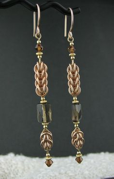 Long Rose Goldfill Mixed Metals Chainmaille Earrings, Rose and Yellow Goldfill Chainmail Jewelry, Long Chainmail Brown Gemstone Earrings by LoneRockJewelry on Etsy Gemstone Earrings, Beaded Earrings, Earrings Handmade, Beaded Jewelry, Handmade Jewelry, Chain Jewelry, Jewellery, Swarovski Jewelry, Wire Wrapped Jewelry