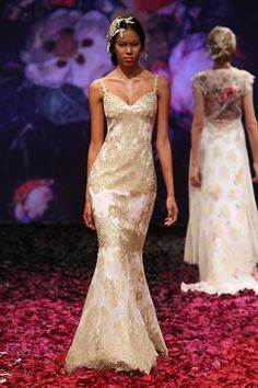 Precious is what comes to mind when you see this designer lace wedding dress. Gold bullion, metallic yarns woven into this fabric gives Alchemy a regal elegance
