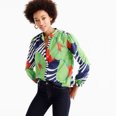 Ever wonder where the world's most amazing prints, scarves and wovens come from? The answer is Ratti, one of the leading producers of fabric for womenswear, furnishings and accessories, located in Como, Italy. We found this vibrant floral in their archives and thought it was the perfect way to make this button-up shirt pop. Body length: 25 1/2. Cotton. Bracelet sleeves. Functional buttons at cuffs. Button placket. Machine wash. Import.