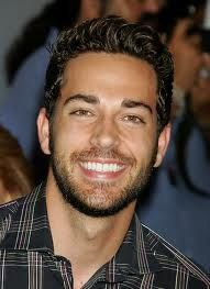Zachary Levi.. gorgeous and he plays one of the most adorable men ever. Flynn Rider :)