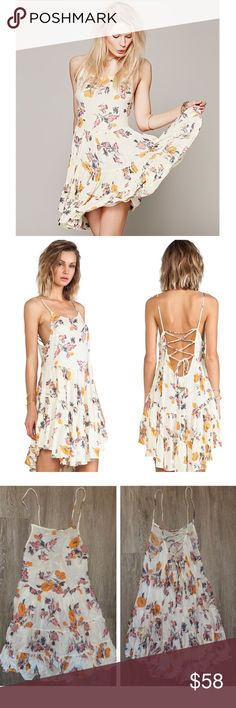 Free People Circle of Flowers Slip Short floral slip from Free People. As seen on Pretty Little Liars. Laces up the back for flexible sizing. Size xs. Free People Dresses Mini