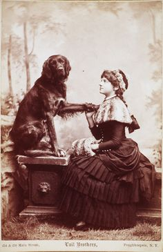 Ca. 1885 (cabinet card, portrait of a lady posed with a partner near and dear to her heart), Vail Brothers