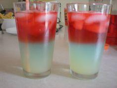 Bomb Pop Drinks! 4th of July...white is lemonade, blue is Gatorade, and red is Cherry UV, enjoy!  From - Bomb Pops! 2 oz Bacardi Razz rum, 2 oz lemonade, and 2 oz Blue Curacao *YUM!!!*