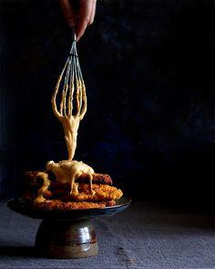 Cornflake chilli chicken schnitzel with 3-cheese fondue sauce.