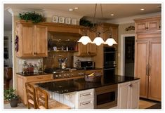 Hi! I'm still struggling with a choice for granite to go with butter yellow walls and stainless appliances.Would love to see some pictures of finished kitchen with honey oak cabinets and get a few suggestions for granite, Thanks all for the help.