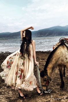 Ride a  horse to the beach in a dress