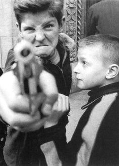 Boy pointing gun ~ William Klein   ~ this photo' was taken circa 1954, in America 1954. Klein saw the boy on the streets and took this shot, but is the youngster really full of anger?