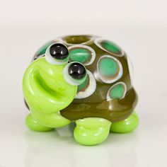 """Green Turtle Lampwork Glass Bead. $17.00, via Etsy. From Maybeads. I would """"heart"""" this little guy a million times if I could. Makes me miss the days I used to make smiling turtles out of polymer clay. <3"""