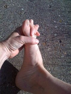 "Try to thread your fingers between your toes from under the foot. This is commonly known as the ""yoga handshake"" and is replicated with YogaToes."
