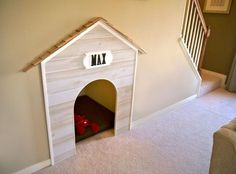 Puppy cave under the staircase! Such a good way to keep ugly pet beds out of the way.