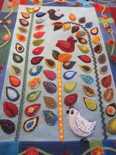 Sue Spargo wool applique with embroidery, tall stemmed leaves (flowers?) with birds Wool Applique Quilts, Wool Quilts, Crewel Embroidery Kits, Embroidery Books, Embroidery Alphabet, Embroidery Shop, Embroidery Patterns, Felt Crafts, Fabric Crafts
