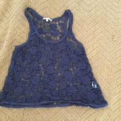Crochet Crop Top Navy blue, size medium but fits like a small. Looks cute over a bathing suit or with a tank top under it! No imperfections and smoke free home :) dELiA*s Tops Crop Tops