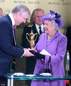 Duke of York awards his mother Queen Elizabeth II the Gold Cup after her horse Estimate wins at Royal Ascot premiere race 6/20/13
