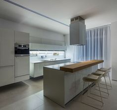 Open and Dynamic Interior in White by Ivan Yurima architects